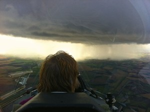 The back of Pauline Larners head watching an approaching shower cloud before a dash for the airfield