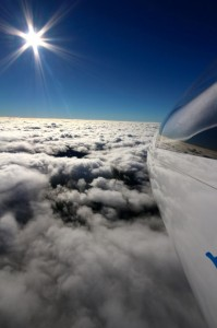 wave soaring in the sunlight above teh clouds not far away from the club